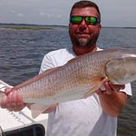 Catching these giant redfish are my specialty.