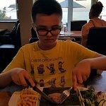 Enjoying his fillet steak!
