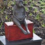 Monkey statue a pool
