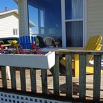 Front deck with flowers and plenty of chairs