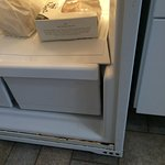 rusted refrigerator/broken shelf/drawers