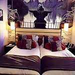 Bedroom with art work over the head board