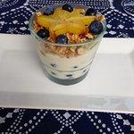 Yogurt parfait with kiwi, blueberries, star fruit, granola and orange yogurt!