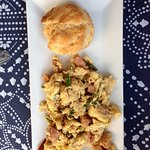 Scrambled eggs with country ham, gouda cheese, and veggies, with a rosemary biscuit!