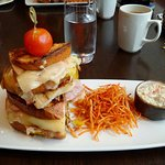 Grilled Cubano sandwich with stringy fries and coleslaw.