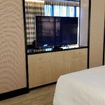 Suite dividing wall with television and dresser