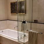 Deep soaking tub and glassed in shower