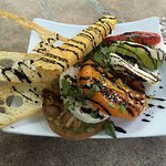 Caprese salad with heirloom tomatoes and fresh local-made mozzarlla