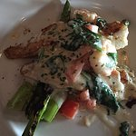 Grilled shrimp and scallops over asparagus and sautes spinach