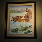 Beautiful framed artwork at main entrance on upper level