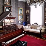 Drawing room with Grand piano wired for automatic playing.