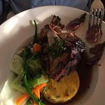 slow roasted lamb shank with polenta and vegetables