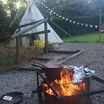 Smoking food on the fire pit outside the tipi. Fantastic.