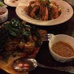 spicy crispy shrimp atop mix vegetables & lemon grass chicken both with dipping peanut dipping s