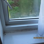 grubby, dirty curtains and window sills room 211