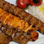 The mixed grill for two which includes 4 diffrent skewers and two portion of rice or breaks