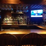 Full bar all the way to the right when you walk in.