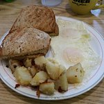 Eggs, rye toast, and home fries.