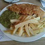 Cod, *half a portion* of chips and mushy peas, Wonderful.