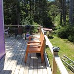 Large outside deck with patio furniture and BBQ