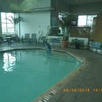 Indoor pool area with restaurant to right.