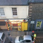Busy takeaway pizza shop opposite