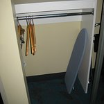 Closet with low hanger rack and mini-ironing board