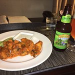 Room service chicken and beer.