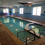 Indoor pool, smaller area is jacuzzi. Motor timer switch on wall.