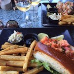 Lobster roll and Seafood roll with french fries and coleslaw plus a bottle of Riesling
