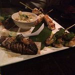 Duck breast, Filet mignon, sea bass and shrips (going clock wise)