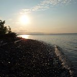 Lake Superior sunset from beach at Lake Shore Salzburger Hof Resort.
