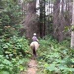 N riding Butch through the trees