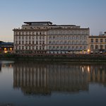 View of the hotel from across the Arno. Se Sto located in the glass addition & the patio on the