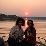 Enjoying a glass of wine on our boat ride to Sindabezi Island on the Zambezi River