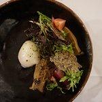 King oyster mushroom, shitake, slow-cooked hen's egg, radish salad, raspberry dressing