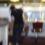 Blurry, but you are seeing a waitress giving a girl corn row braids at the counter.