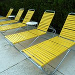 Yellow chairs by the pool.