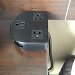 Electicral outlet extender on bedside table
