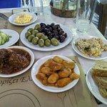 spicy feta, olives, potato salad, tuna salad, pork stew, bean stew