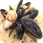 Chilean Seabass with cauliflower purée, seafood chowder and steamed mussels appetizer.