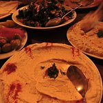 clockwise from left - appetisers, fatoush, baba ghanoush, hummus