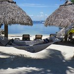 Take a siesta in a hammock by the beach.