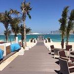 Walk up to the beach bar/jetty
