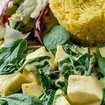 Paneer-spinach saute Paneer and spinach with sour cream, basmati rice and salad
