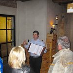 Sommelier, Jason Drotar, Conducting Wine Tasting in the Wine Room Below The Barn