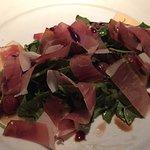 Prosciutto with melon and arugula salad