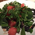 Watermelon and arugula salad with octopus