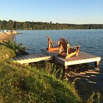 a number of private docks with adirondacks to watch the sunset