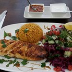 Grilled salmon, cuscus and salad.